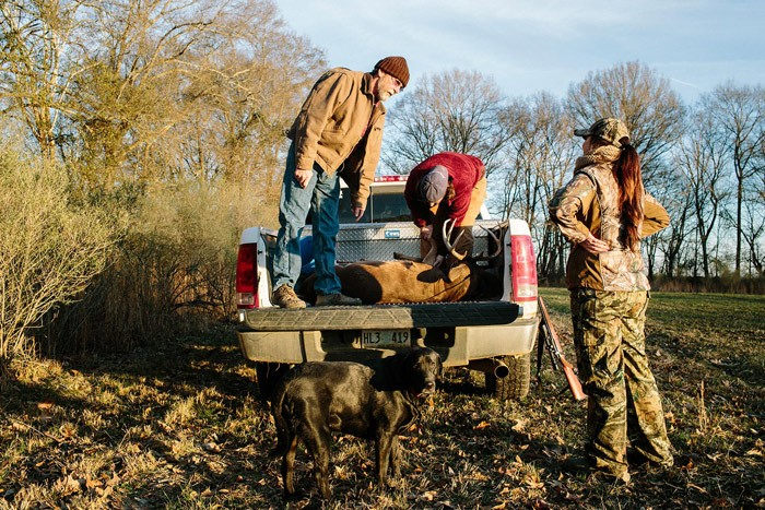 women_hunting_buck_truck